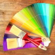 Stock Photo: Paint brushes and bright palette of colors on wooden background