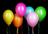 Colorful balloons isolated on black background — Stock Photo