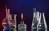 Spiritlamp and test-tubes on blue-red background — Foto Stock