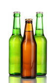 Three bottles of beer isolated on white — Stock Photo