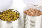 Open tin cans of beans and peas isolated on white — Stock Photo