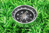 Compass on green grass — Stock Photo