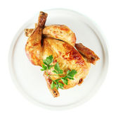 Roasted whole chicken on a white plate isolated on white — Stock Photo