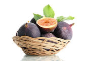Ripe sweet figs with leaves in basket isolated on white — Stock Photo