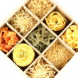 Nine types of pasta in wooden box sections close-up isolated on white - Stockfoto
