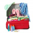 Stock Photo: Red travel suitcase with personal belongings isolated on white