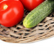 Ripe cucumbers and tomatoes isolated on white — Stock Photo