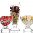 Mixed fruits and berries in glasses isolated on white — Stock Photo #12884585