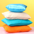 Colorful pillows on yellow background — Stock Photo #12885399