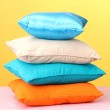 Colorful pillows on yellow background — Stock Photo