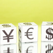 Forex. currency in the white dices on green background - Stock Photo