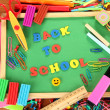 Small chalkboard with school supplies on wooden background. Back to School - Foto Stock