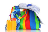 Beach bag with accessories isolated on white — Stock Photo