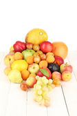 Still life of fruit on wooden table isolated on white — Stock Photo