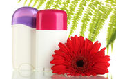 Deodorants with flower and green leaf isolated on white — Stock Photo
