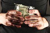 Homeless holds bank with money, close-up — Stock Photo