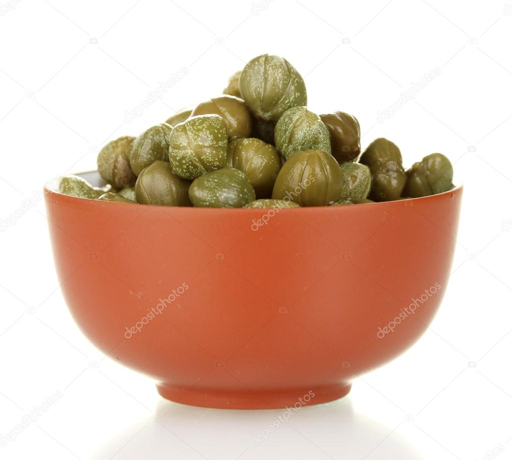 Green capers in ceramical bowl isolated on white background — Stock Photo #12889005