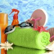 Bright beach accessories, on blue sea background — Stock Photo