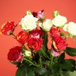 Bouquet of beautiful roses on red background close-up — Stock Photo #12896985