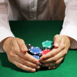 Taking win in poker on green table — Stock Photo