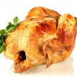 Whole roasted chicken with parsley isolated on white - Stock Photo