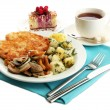 Roast chicken cutlet with boiled potatoes and  vegetables, cup of tea and d - Stock Photo