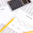 Documents, calculator and glasses close-up - Stock Photo
