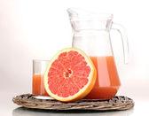 Grapefruit juice and grapefruit isolated on white — Stock Photo