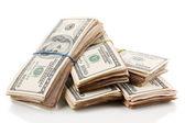 Pilas de primer plano de los billetes de cien dólares aislado en blanco — Foto de Stock