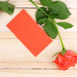 Beautiful rose on wooden background — Foto de Stock