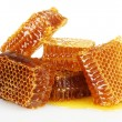 Photo: Sweet honeycombs with honey, isolated on white