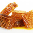 Sweet honeycombs with honey, isolated on white — Stockfoto