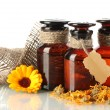 Medicine bottles and calendula, isolated on white — Stockfoto