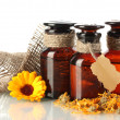 Medicine bottles and calendula, isolated on white — Lizenzfreies Foto