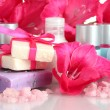 Cosmetic bottles, soap and flowers - Stock Photo