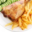 Roast chicken with french fries and cucumbers on plate, isolated on white - Stockfoto