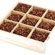 Coffee beans in wooden box isolated on white - Stock fotografie