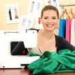 Beautiful young dressmaker in workroom — Stock Photo #13197936