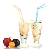 Milk shakes with fruit isolated on white close-up — Stock Photo
