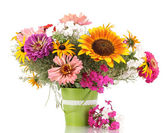 Beautiful bouquet of bright flowers in pail isolated on white — Stock Photo
