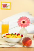 Light breakfast on the nightstand next to the bed — Stock Photo