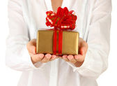 Woman holds a box with a gift on white background close-up — Stock Photo