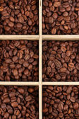 Coffee beans in wooden box close-up — Stok fotoğraf