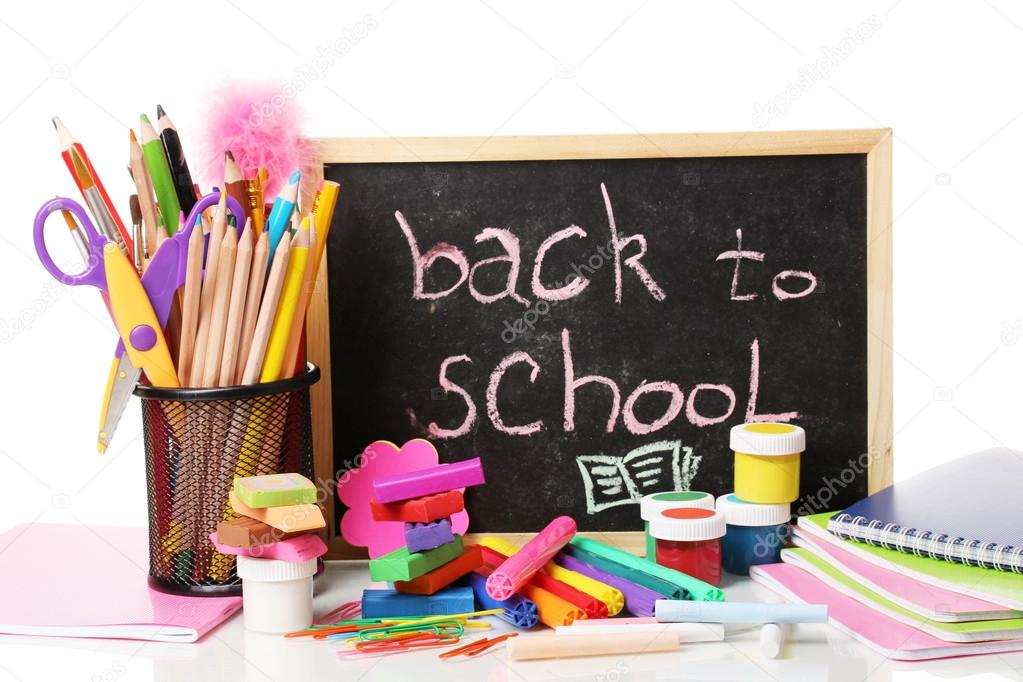 The words 'Back to School' written in chalk on the small school desk with various school supplies close-up isolated on white — Stock Photo #13197541