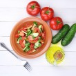 Fresh salad with tomatoes and cucumbers on white wooden background — Stock Photo #13208869