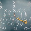 American football plan on blackboard - 