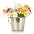 Beautiful bouquet of bright wildflowers in metal bucket, isolated on whit — Stock Photo #13209108