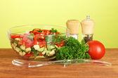 Fresh salad on green background — Stock Photo