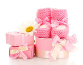Pink baby boots, gifts and flower isolated on white — Stock Photo