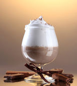 Glass of coffee cocktail on brown background — Photo